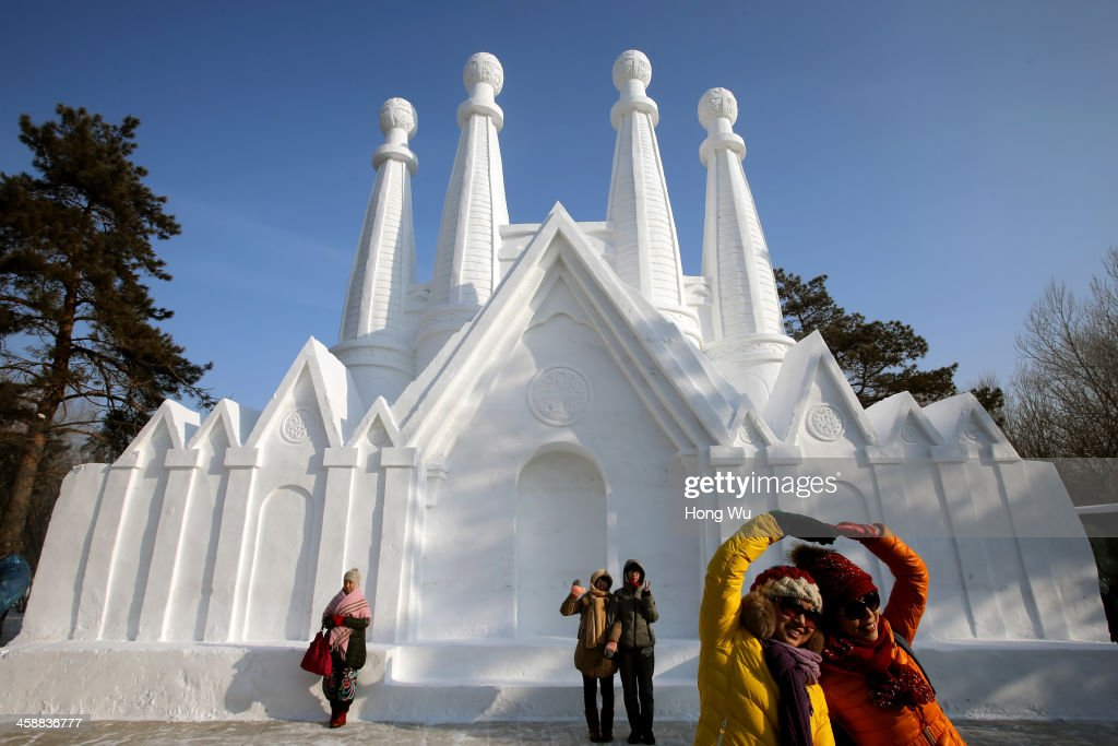 People view a large snow sculpture at the 26th Harbin International Snow Sculpture Art Expo in Sun Island park on December 22, 2013 in Harbin, China. The Harbin International Ice and Snow Sculpture Festival is one of the largest ice and snow festivals in the world and is a popular winter destination for both Chinese and foreign visitors.