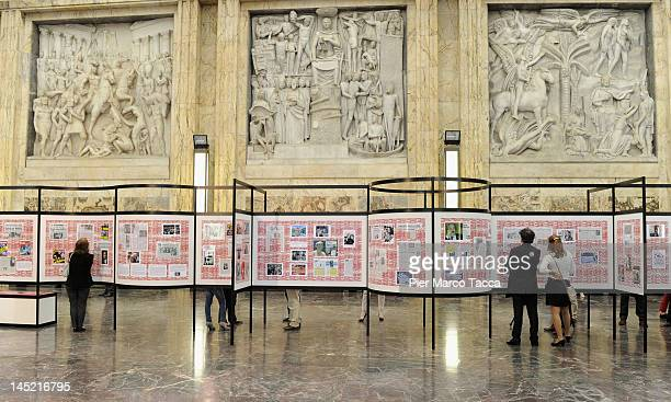 People view a photo exhibition in memory of magistrates Giovanni Falcone and Paolo Borsellino on the 20th Anniversary of Capaci Mafia attack on May...