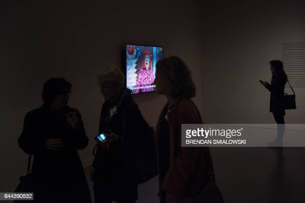 People view a preview of the Yayoi Kusama's Infinity Mirrors exhibit at the Hirshhorn Museum February 21 2017 in Washington DC Kusama has two major...