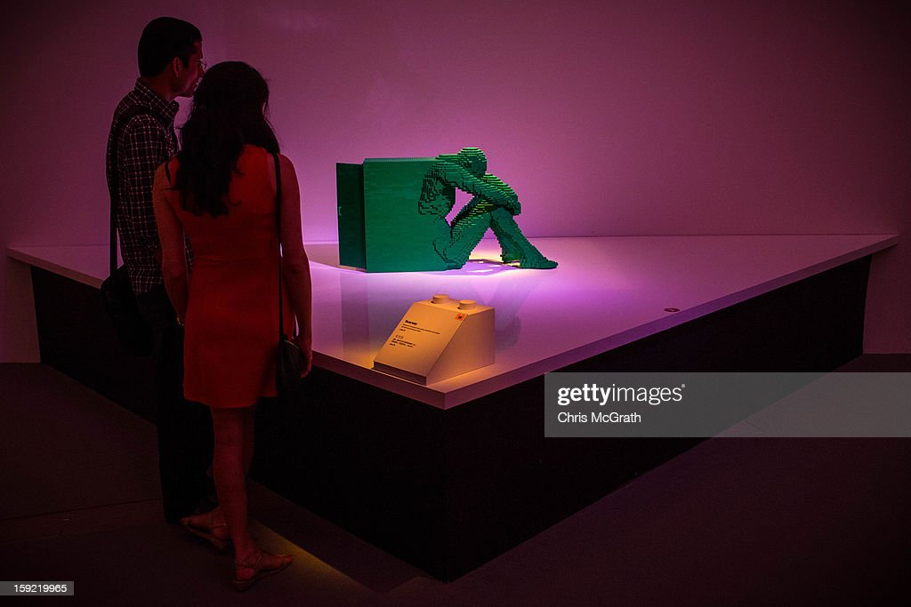 People view a sculpture made out of Lego at the 'The Art of the Brick' exhibition on January 9, 2013 at the ArtScience Museum in Singapore. The exhibition by renowned New York based brick artist Nathan Sawaya features 52 large-scale LEGO brick sculptures and showcases two of the artists iconic pieces 'Yellow' and 'Swimmer'. It is the first time his work has been exhibited in South East Asia. The exhibit runs from 17 Nov 2012 to 14 April 2013.