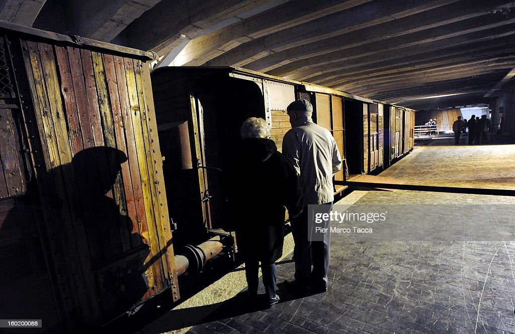 People view a train carriage, part of a memorial at Platform 21 (Binario 21), which was used for transporting Jews to concentration camps during World War II, during the opening of 'Memoriale della Shoa' on International Holocaust Remembrance Day on January 27, 2013 in Milan, Italy. 'Memoriale della Shoa' is located at Platform 21 (Binario 21), which formed part of a secret underground rail network that transported hundreds of Jews to camps such as Auschwitz and Dachau, from1943 to 1945.