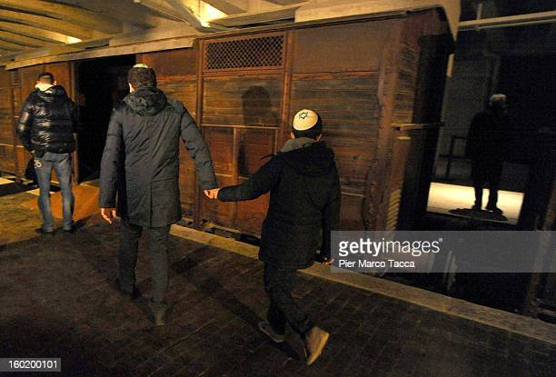 People view a train carriage part of a memorial at Platform 21 which was used for transporting Jews to concentration camps during World War II during...