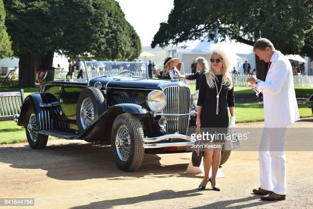 People view a vintage car at the Concours of Elegance at Hampton Court Palace on September 1 2017 in London England The show brings together a...