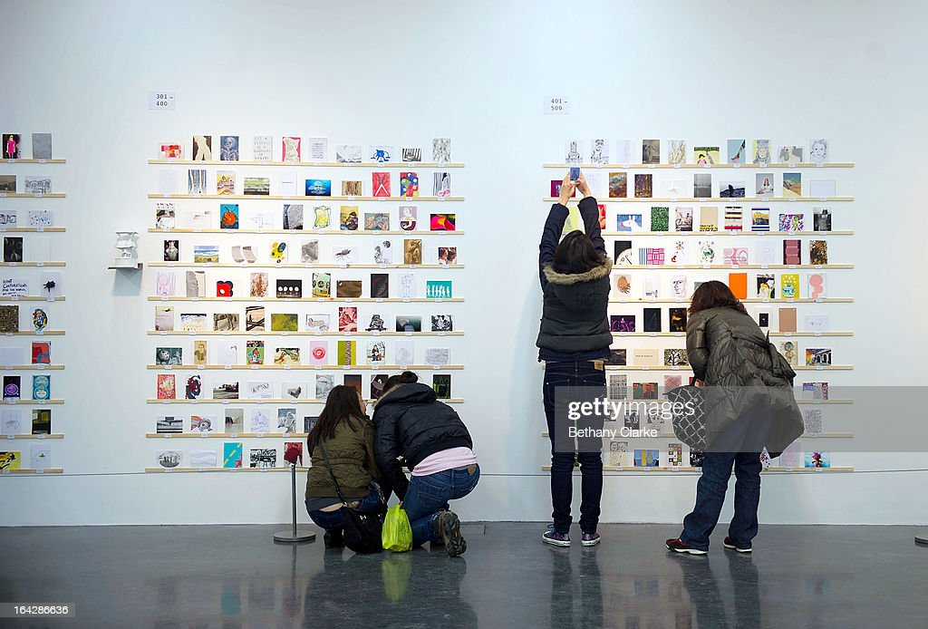 People view an exhibition of 2,700 post-card size artworks at the Royal College of Art on March 22, 2013 in London, England. The Artworks, including work by Julian Opie, Paula Rego, David Bailey, Sir Paul Smith and Nick Park will go on sale on Saturday 23 March from 7am, costing just £45 each. The creators of the postcards remain anonymous until they are bought and the signature is revealed on the back. The RCA are hoping to raise over £120,000 from this year's sale.
