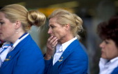 People view at a makeshift memorial for the passengers aboard doomed flight Malaysia Airlines MH17 at Schiphol Airport July 20 2014 in Amsterdam the...