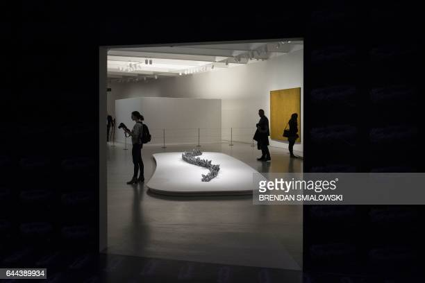 People view exhibits during a preview of the Yayoi Kusama's Infinity Mirrors exhibit at the Hirshhorn Museum February 21 2017 in Washington DC Kusama...