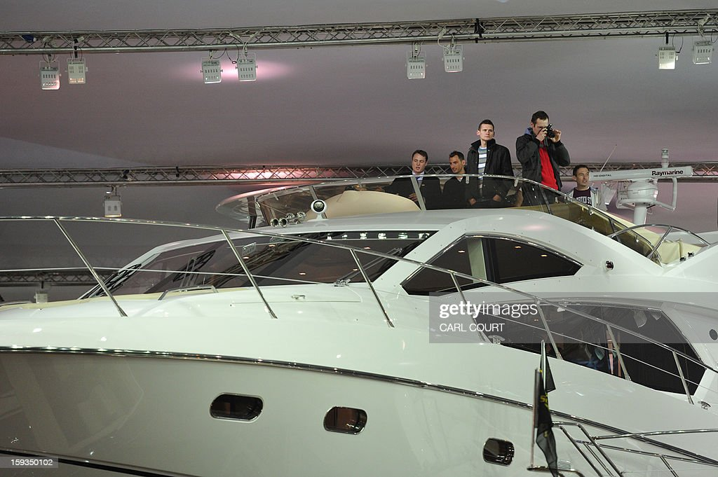 People view luxury motor boats on display at the 2013 London Boat Show in east London on January 12, 2013. The nine-day show features everything from speedboats to dinghies, boat paint to hot tubs with exhibits from many major marine and watersports related brands.