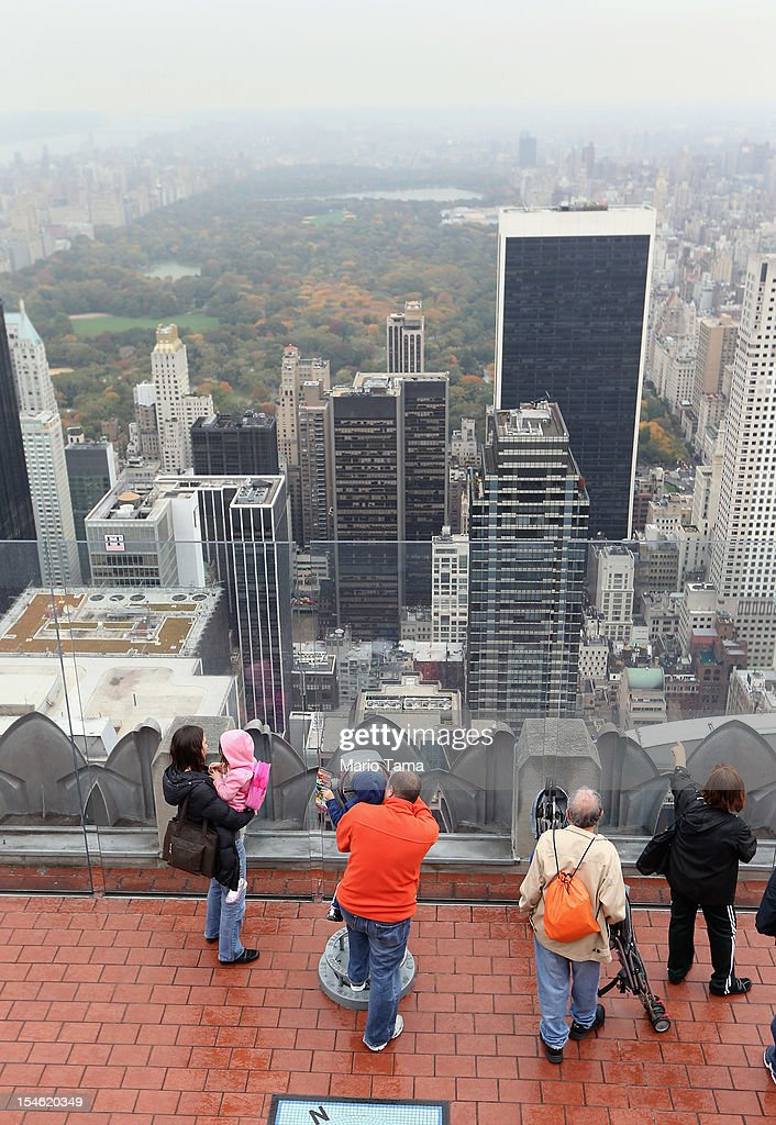 People view Manhattan and Central Park from the 'Top of the Rock' observation deck at Rockefeller Center on October 23 2012 in New York City Hedge...