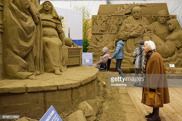 A people view one of the sculptures at the Jesolo Sand Nativity 2016 on December 13 2016 in Jesolo Italy
