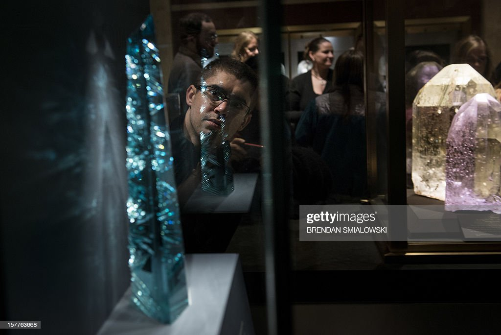People view the Dom Pedro after its unveiling in the Janet Annenberg Hooker Hall of Geology, Gems and Minerals at the Smithsonian's National Museum of Natural History December 6, 2012 in Washington, DC. The Dom Pedro aquamarine, currently considered the largest single piece of cut gem aquamarine in the world, was donated to the Smithsonian by Jane Mitchell and her husband Jeffrey Bland. AFP PHOTO/Brendan SMIALOWSKI