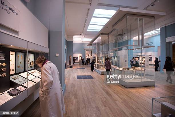 People view the historic artifacts on display in the new gallery 'Sutton Hoo and Europe AD 3001100' in the British Museum on March 25 2014 in London...