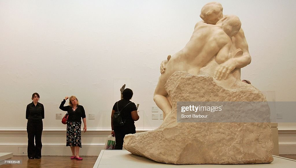 People view 'The Kiss' by French sculptor Auguste Rodin during the press launch of the Rodin exhibition at the Royal Academy of Arts on September 19...