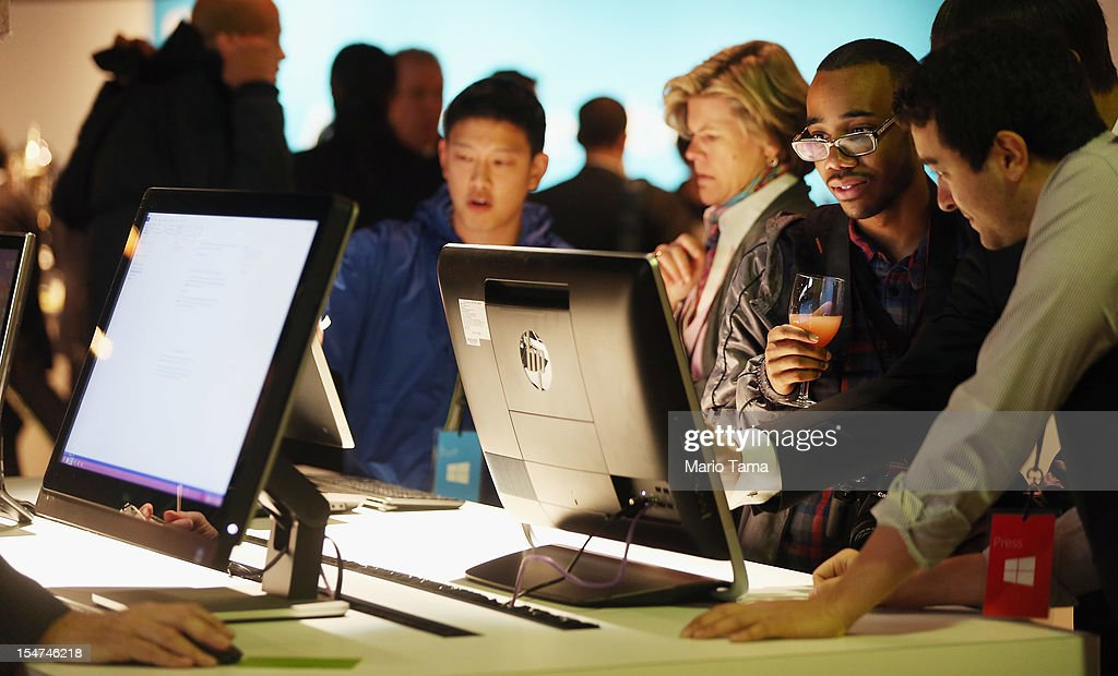People view the Microsoft Windows 8 operating system at a press conference for the launch of the system on October 25, 2012 in New York City. Windows 8 offers a touch interface in an effort to bridge the gap between tablets and personal computers.