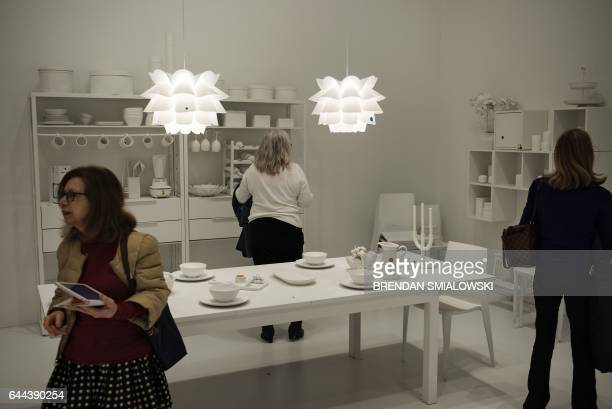 People view the obliteration room during a preview of the Yayoi Kusama's Infinity Mirrors exhibit at the Hirshhorn Museum February 21 2017 in...