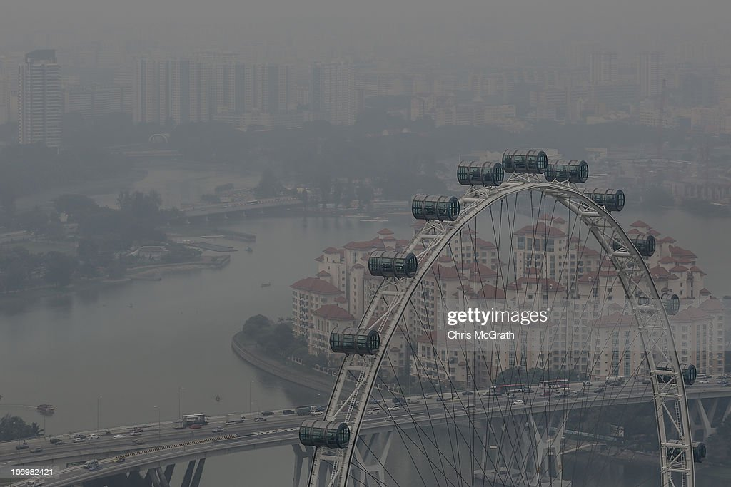 People view the Singapore skyline covered in smoke haze from the Singapore flyer on April 19, 2013 in Singapore. The haze was created by burning off in neighbouring Sumatra and caused the Pollutant Standards Index to rise, hovering between 28 and 43.