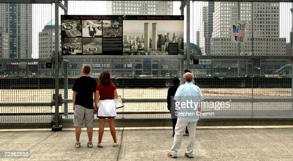 People view the site of the September 11 2001 terrorist attacks May 18 2004 in New York City The 9/11 Commission is conducting hearings in New York...