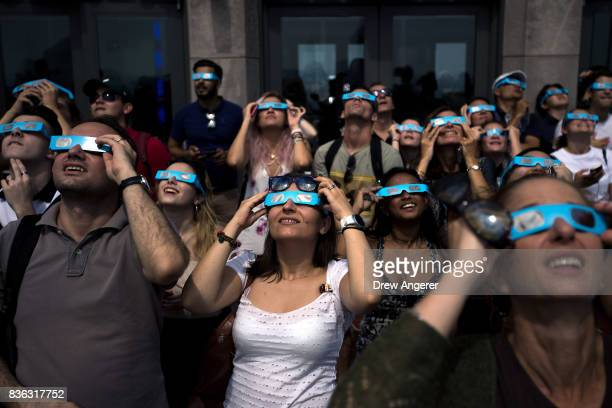 People view the solar eclipse at 'Top of the Rock' observatory at Rockefeller Center August 21 2017 in New York City While New York City is not in...
