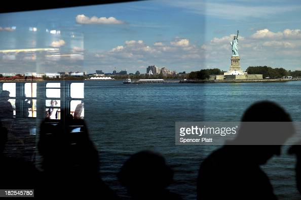 People view the Statue of Liberty one of New York's premiere tourist attractions from the Staten Island Ferry on September 30 2013 in New York City...