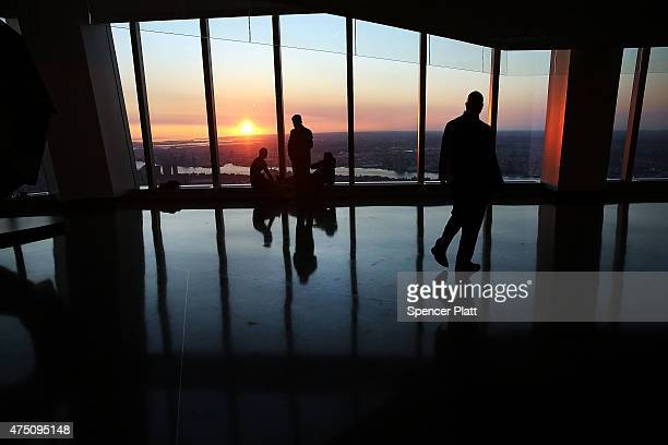 People view the sunrise at the newly built One World Observatory at One World Trade Center on the day it opens to the public on May 29 2015 in New...