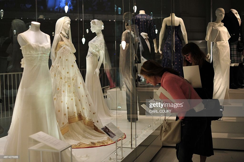 People view wedding dresses during a press preview for an exhibition entitled 'Wedding Dresses 17752014' at the Victoria Albert Museum in London on...