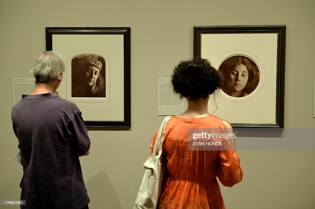 People view 'Zoe, Maid of Athens, 1866' (L) a photograph of Mary Prinsep and 'Kate Keown, 1866' (R) on display in the exhibition 'Julia Margaret Cameron' featuring work by the great British photographer Julia Margaret Cameron (1815-1879) August 19, 2013 at The Metropolitan Museum of Art in New York. The exhibition is open from August 19, 2013 to January 5, 2014. AFP PHOTO/Stan HONDA
