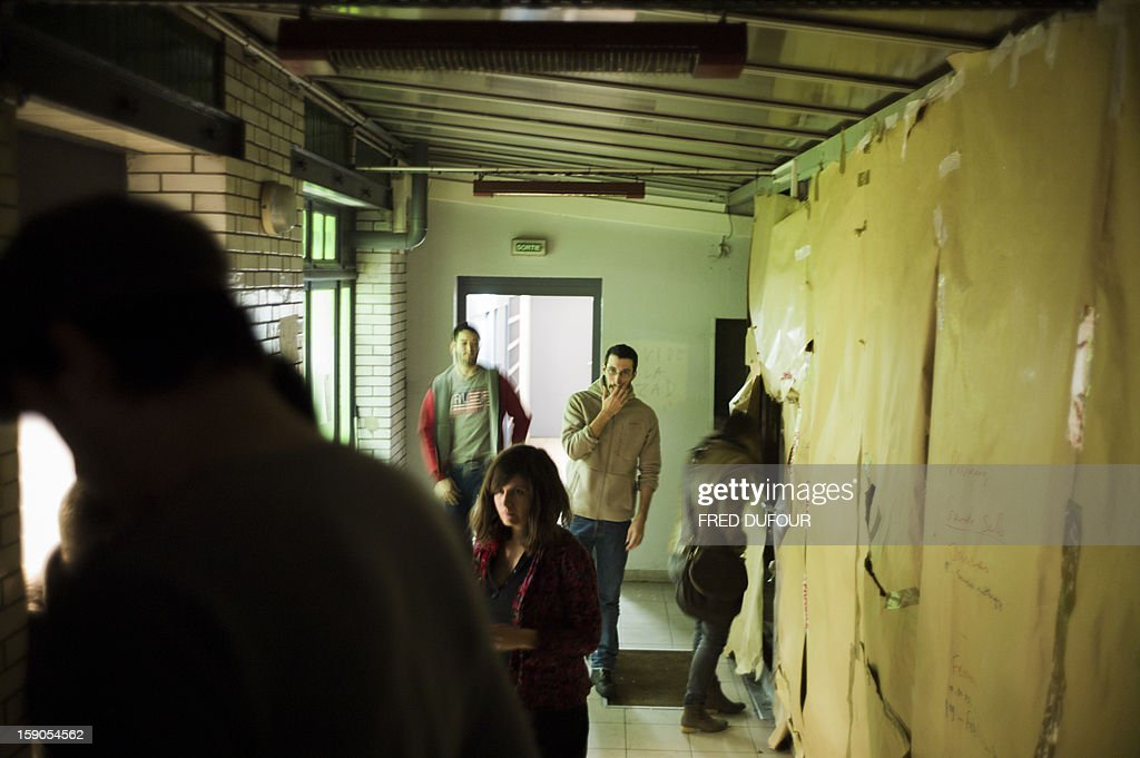 People visit a building requisitioned by French associations 'Jeudi Noir' ('Black Thursday') and 'Droit Au Logement', ('Right to Housing Association', DAL), on January 6 , 2013 in Paris. The building, situated in the 10th arrondissement of Paris is occupied since December 31, 2012.