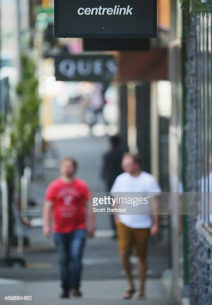 People visit a Centrelink office on October 9 2014 in Melbourne Australia Economists expect the Australian jobs figure for September to show an...