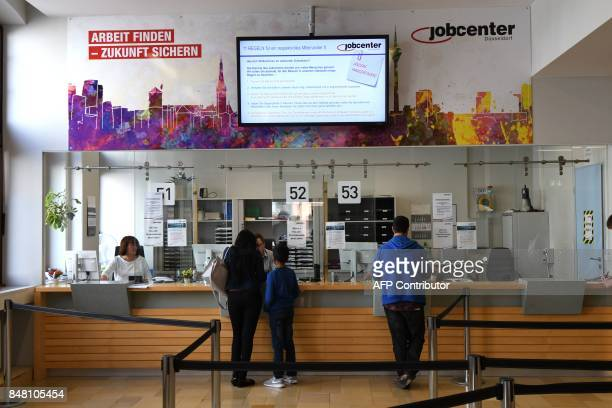 People visit a Jobcenter in DuesseldorfMitte western Germany on August 25 2017 The number of people out of work has halved in Germany since 2005 but...