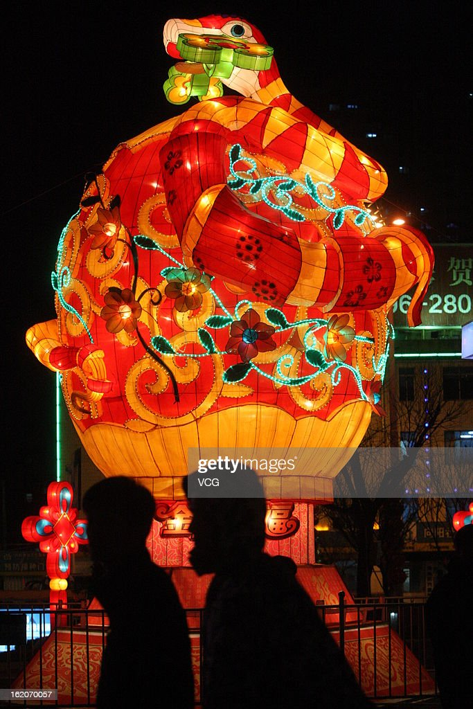 People visit a lantern show to celebrate the Spring Festival on February 18, 2013 in Yantai, China. The Chinese Lunar New Year also known as the Spring Festival, which is based on the Lunisolar Chinese calendar, is celebrated from the first day of the first month of the lunar year and ends with Lantern Festival on the Fifteenth day. 2013 is the Year of the Snake according the 12-year cycle of animals which appear in the Chinese Zodiac.