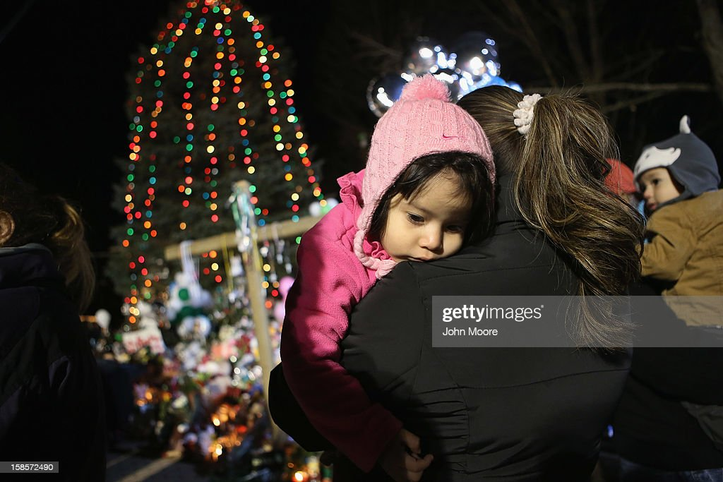 People visit a makeshift memorial for Sandy Hook shooting victims on December 19, 2012 in Newtown, Connecticut. Adam Lanza reportedly shot his mother Nancy Lanza last Friday before he killed 26 others, including 20 children, at Sandy Hook Elementary School.