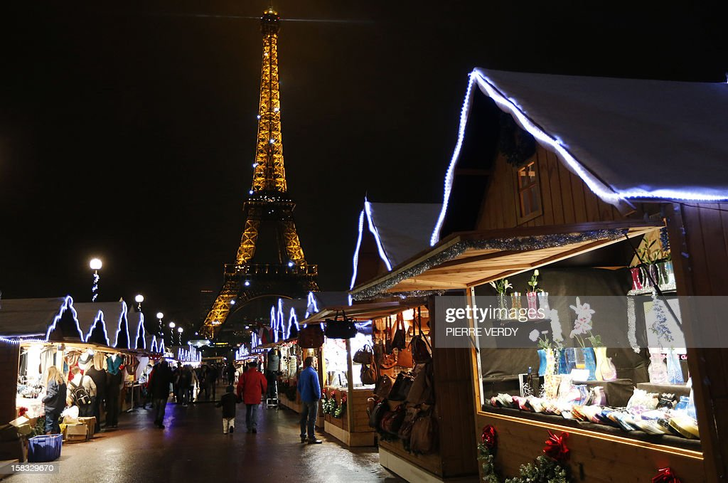 People visit a market in the 'Christmas village' during its inauguration on December 13, 2012, in Paris, as part of the 'Trocadero On Ice' event. An ice-skating rink also opened to public in front of the Eiffel tower, and will run until January 6, 2013.