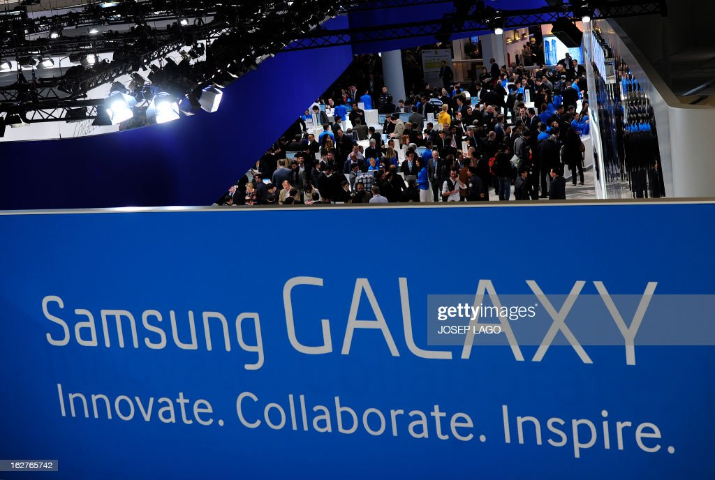 People visit a Samsung stand in Barcelona on February 26, 2013, on the second day of the 2013 Mobile World Congress. The 2013 Mobile World Congress, the world's biggest mobile fair, is held from February 25 to 28 in Barcelona. US credit card giant Visa announced on February 25 a global alliance with Samsung to let shoppers make payments by waving their smartphones near a special reader. AFP PHOTO / JOSEP LAGO