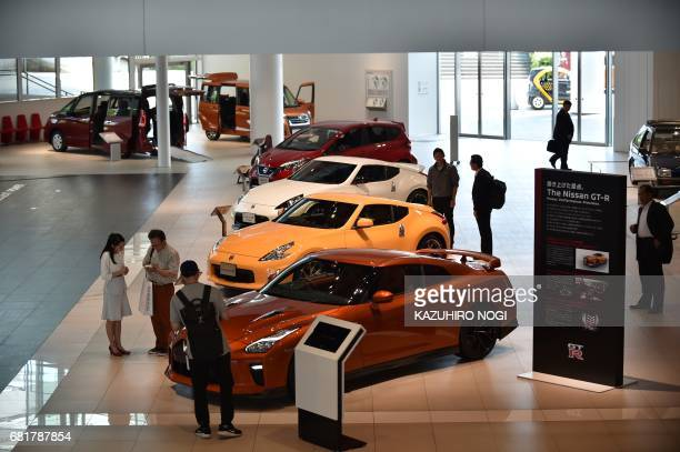 People visit a showroom displayed Nissan Motor's latest cars at Nissan Global Headquarters in Yokohama Kanagawa prefecture on May 11 2017 Nissan...