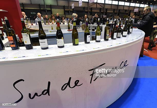 People visit a stand of the 'Millesime Bio 2016' an international organic wine fair on January 26 2016 in Montpellier The event aims at promoting...