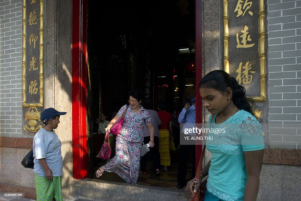 People visit a temple on the first day of the Lunar New Year of the Monkey in Yangon's Chinatown district on February 8, 2016. AFP PHOTO / Ye Aung THU / AFP / Ye Aung Thu