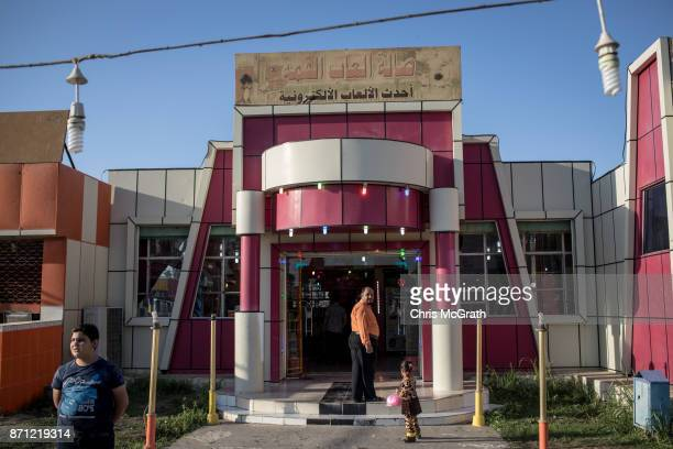 People visit a video game arcade at the Mosul Amusement Park on November 4 2017 in Mosul Iraq The theme park was shut down under ISIS occupation and...