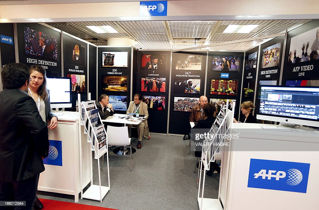 People visit AFP stand at the MIPTV one of the world's largest broadcasting and audio-visual trade show, on April 10, 2013 in Cannes, southeastern France .