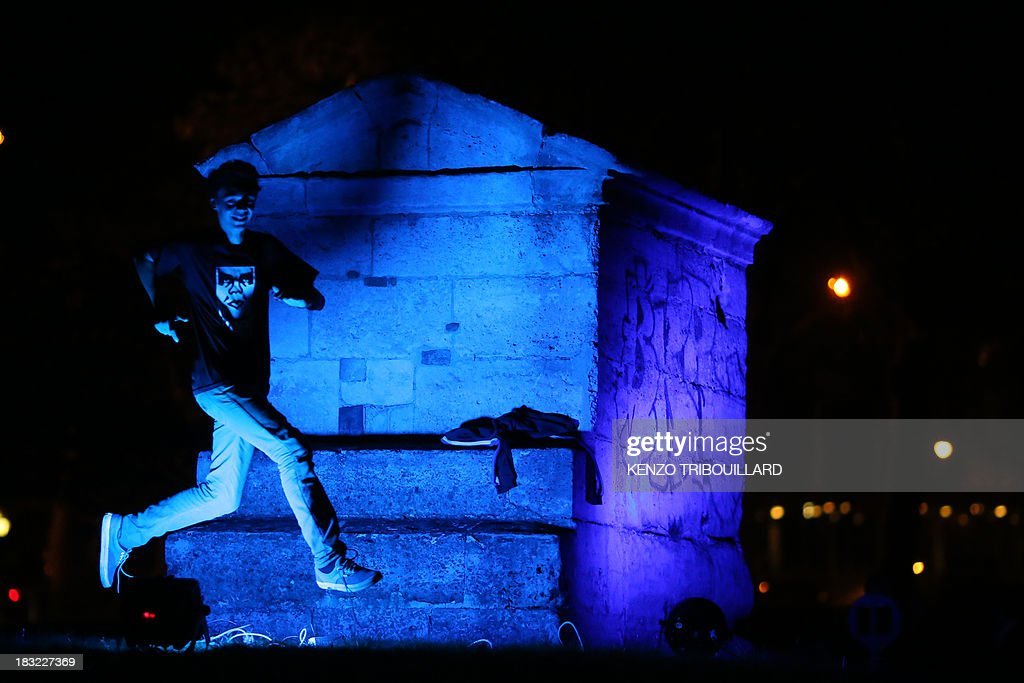 People visit an art installation by artist Sinono on October 05, 2013 at the 'Aqueduc Médicis' in Paris on the eve of Paris' Nuit Blanche (White Night) event.