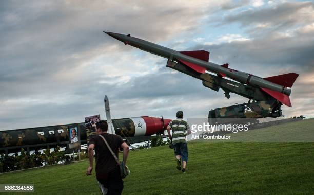 People visit an exhibition of Sovietera armament in La Cabana in Havana on October 16 2017 With three decades of close alliance with the Soviet Union...