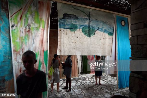People visit an installation by Argentinian artist Vivian Suter called 'Nisyros' at the frames of Documenta 14 art exhibition at Filopappou Hill in...