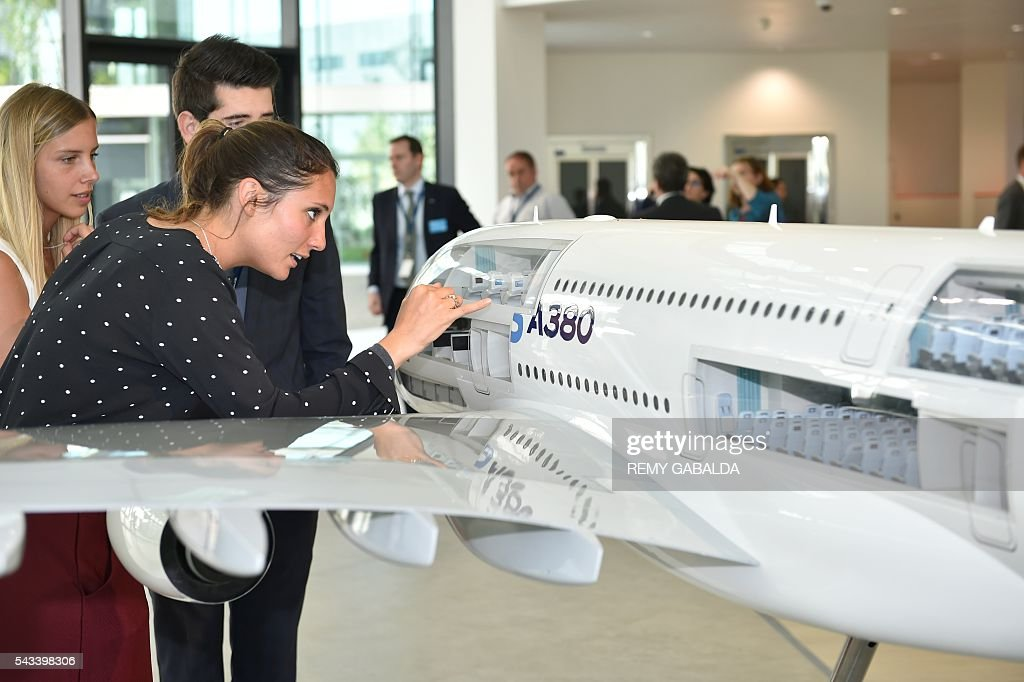 People visit and look at a model of the Airbus plane A380 during the inauguration ceremony of the new headquarters of Airbus Group on June 28, 2016 in Blagnac, on the outskirts of Toulouse. / AFP / Rémy GABALDA