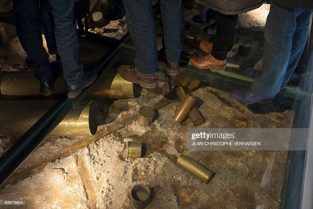 People visit as the look at soldiers belongings and equipment displayed for the exhibition that commemorate the 1916 Battle of Verdun in the redesigned Memorial of Verdun in Fleury-devant-Douaumont, on February 12, 2106. The memorial will reopen on February 22, 2016. VERHAEGEN
