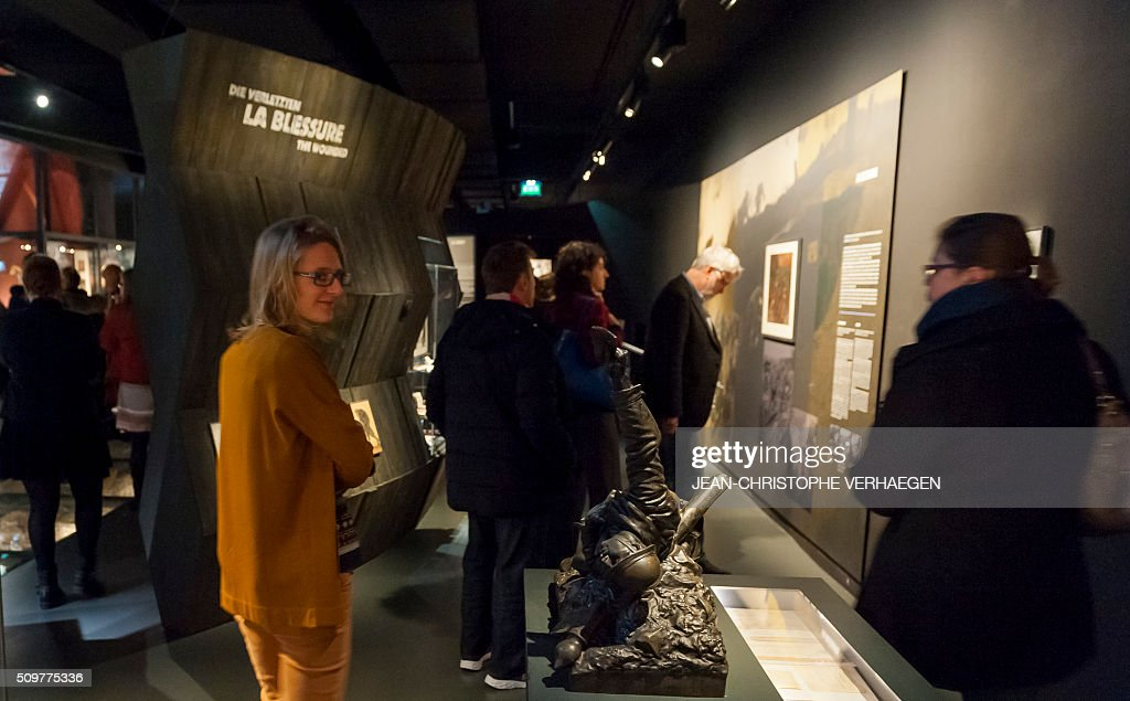 People visit as they look at soldiers belongings and equipment displayed for the exhibition that commemorate the 1916 Battle of Verdun in the redesigned Memorial of Verdun in Fleury-devant-Douaumont, on February 12, 2106. The memorial will reopen on February 22, 2016. VERHAEGEN