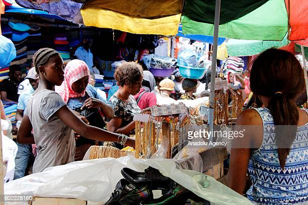 People visit bazaars and markets to shop for the upcoming Muslim sacrificial festival 'Eid alAdha' on the outskirts of Free Town Sierra Leone on...
