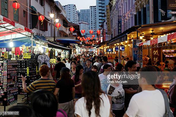 People visit Chinatown on January 18 2012 in Singapore On January 23rd Chinese around the world will welcome the Year of the Dragon one of the most...