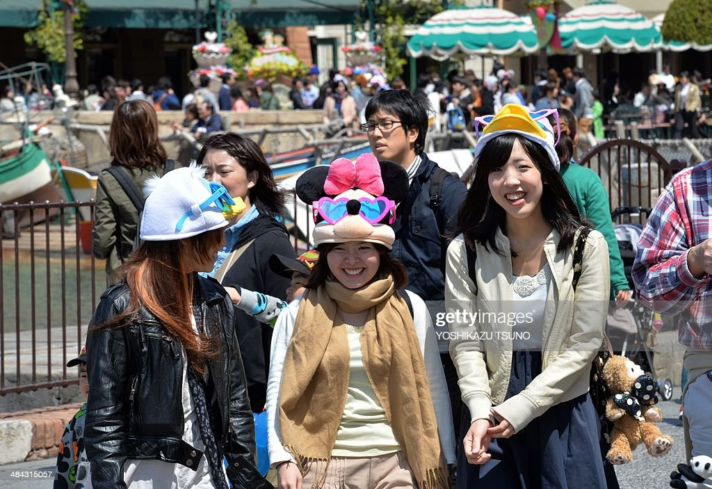 People visit Disney's theme park Tokyo DisneySea in Urayasu, suburban Tokyo on April 12, 2014. Japan's Disney theme parks, Tokyo Disneyland and Tokyo DisneySea, received its 600 millionth guest since its opening on April 15, 1983 and September 4, 2001. The parks logged a record high of 31 million visitors in fiscal 2013 year ended March 31 as the Tokyo Disneyland commemorated its 30th anniversary last year. AFP PHOTO / Yoshikazu TSUNO
