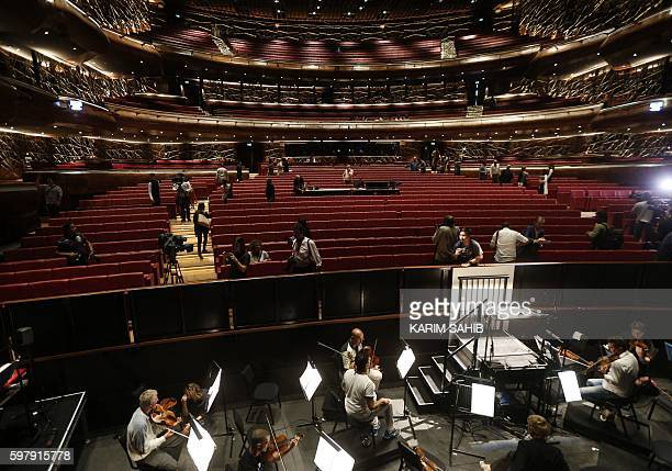 People visit Dubai's new opera house on the eve of its official opening on August 30 2016 in the Gulf emirate A boatshaped hulk of steel and glass at...
