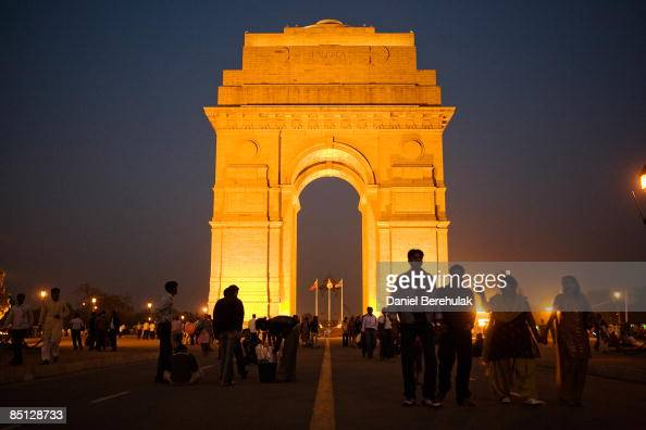 People visit India Gate on February 24 2009 in New Delhi India India gate one of the largest war memorials in India commemorates the members of the...