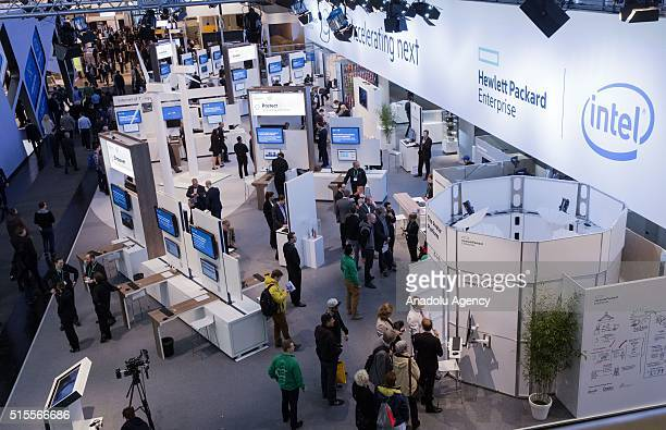 People visit Intel stand during the CeBIT exhibition in Hannover Germany on March 14 2016