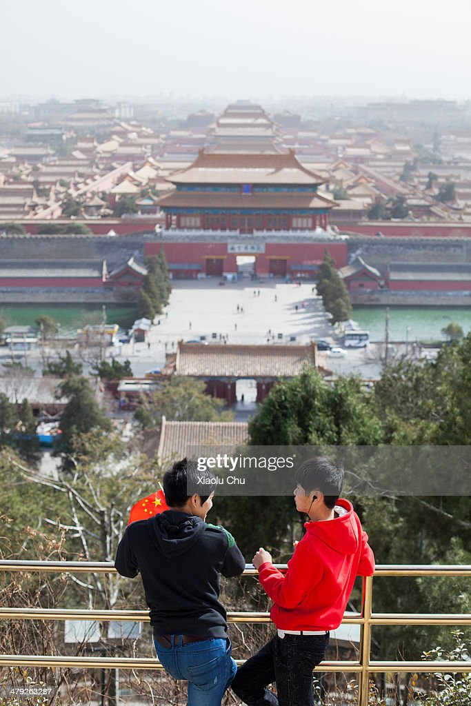 People visit Jingshan Hill that overlooks the Forbidden City as winds dissipate some of the smog on March 17, 2014 in Beijing, China. China is vowing to ammend its procedures to curb pollution as smog in some areas of China have registered over 20 times the level considered safe by the World Health Organization (WHO).